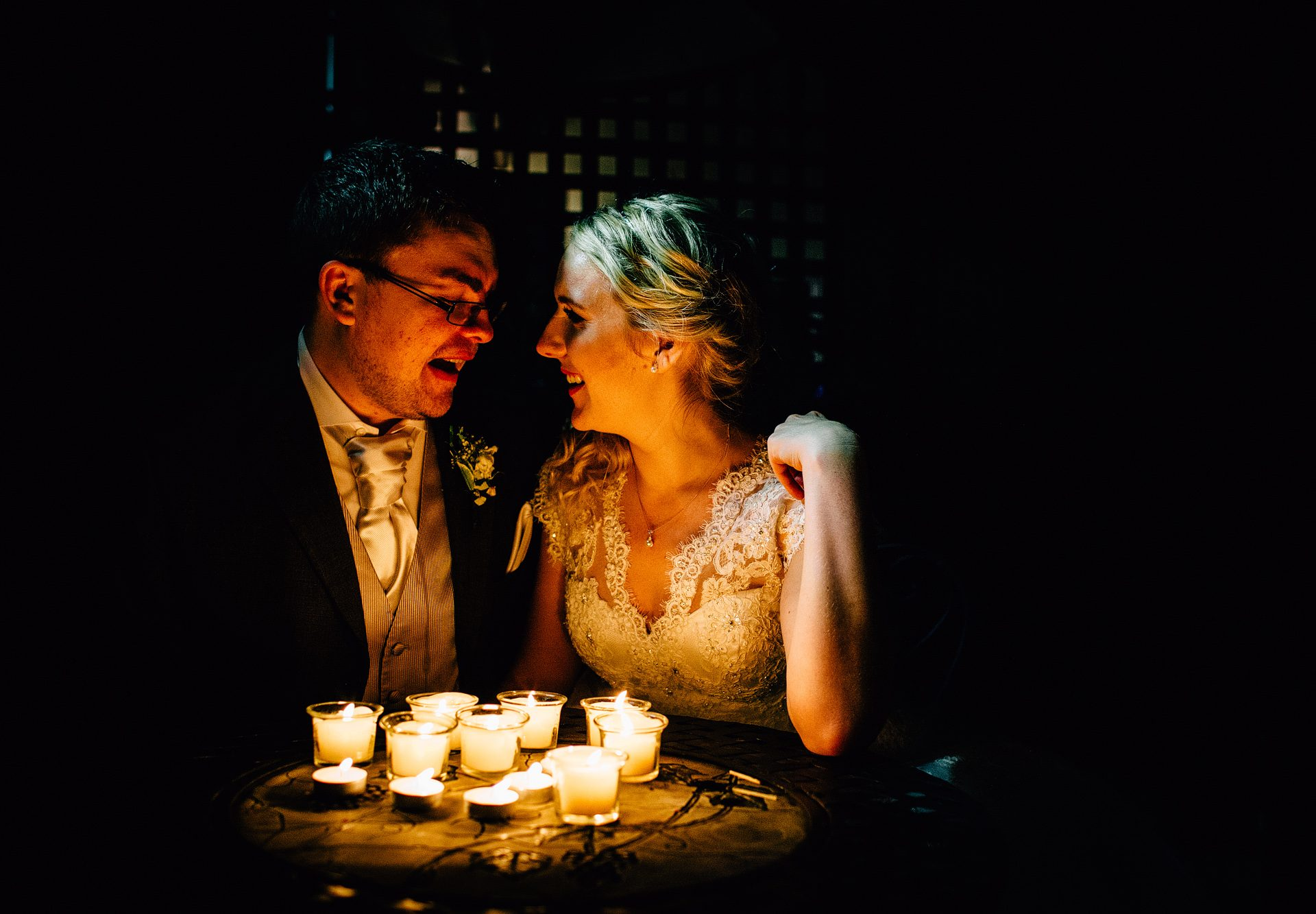 Bride and Groom lit by candlelight