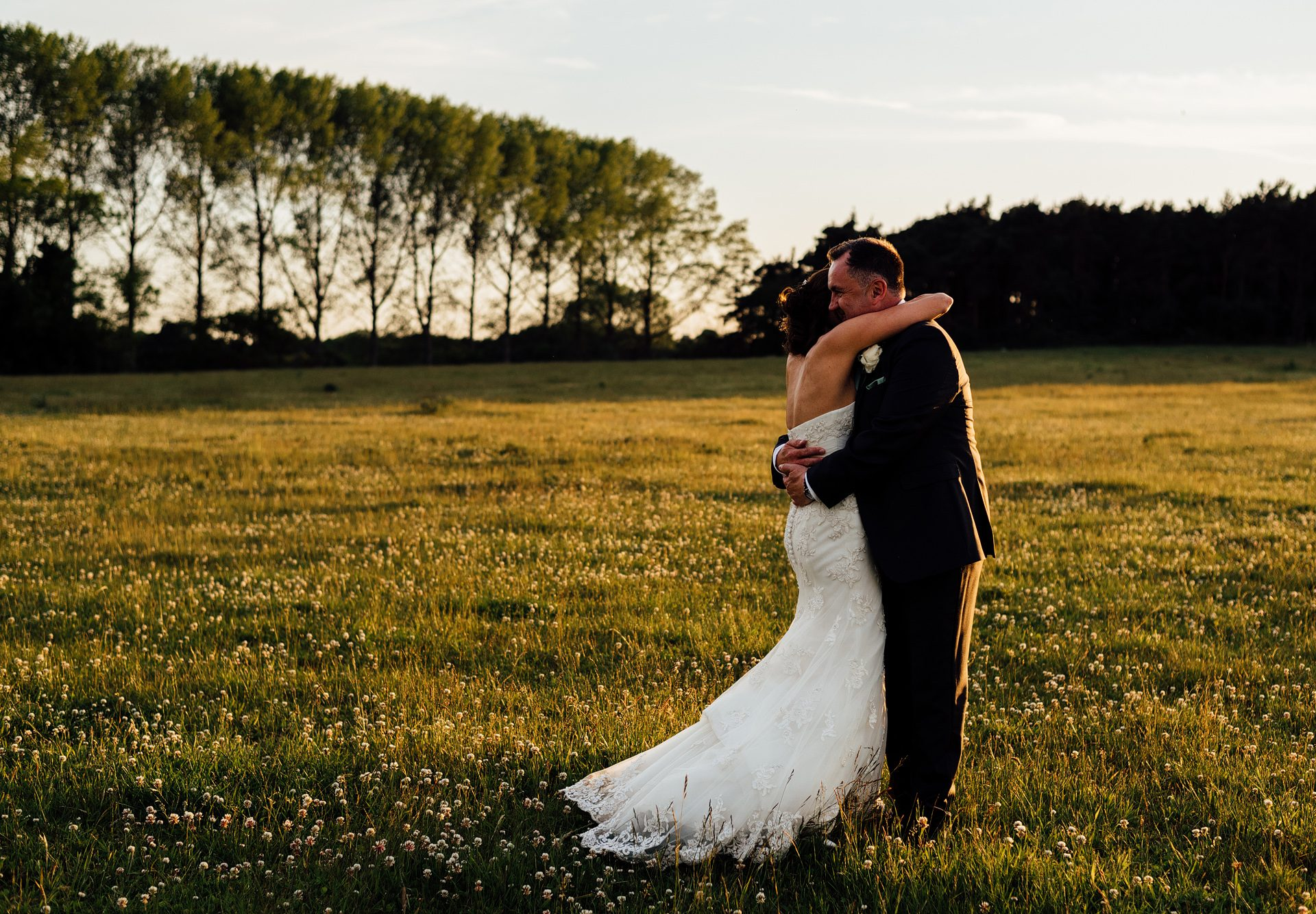 Bride and Groom in Field at Sunset. White Dove Barn Wedding Photographer