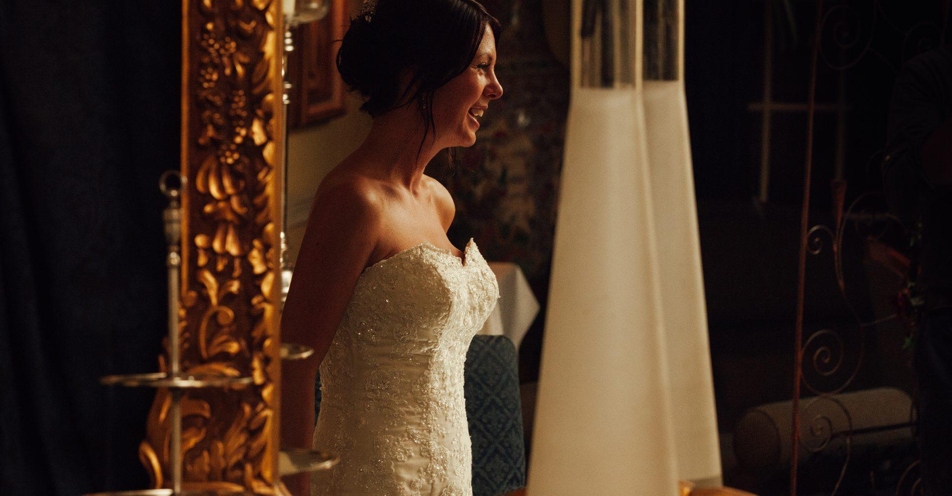 Bride in mirror with warm light