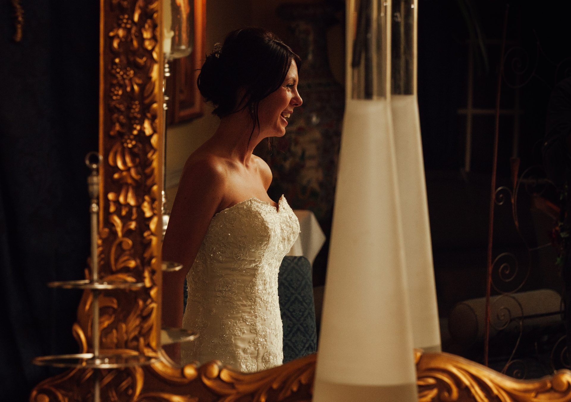 Bride in mirror with warm light