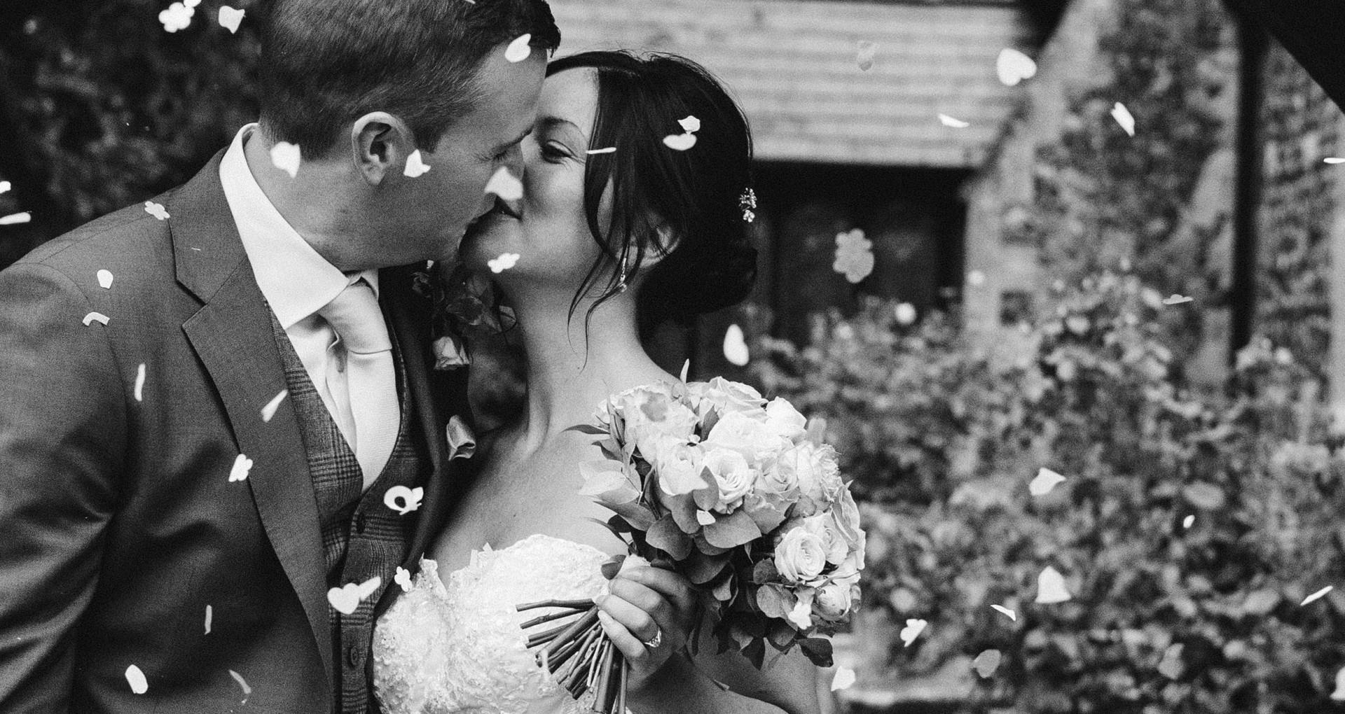 Bride and Groom Confetti Kiss